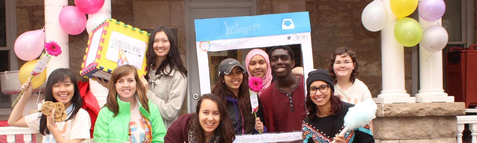 students posing outside raithby house